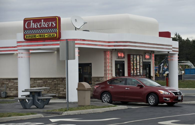 A car drives out of the Checkers Drive-Thru at the Riverton Commons in Front Royal. The business recently reopened.  Rich Cooley/Daily